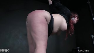 Voluptuous redheaded bitch with a big ass gets punished unconnected with her servitude master