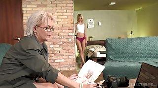 Sexy GILF photographer having sex anent a seductive young woman